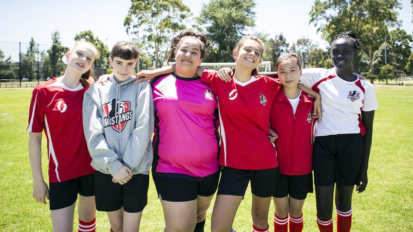 Girls Kicking Goals in Mustangs FC